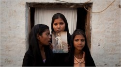 The daughters of Asia Bibi posed with an image of their mother